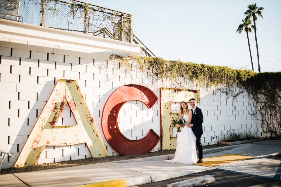 wedding photos at the front of the ace hotel in palm springs