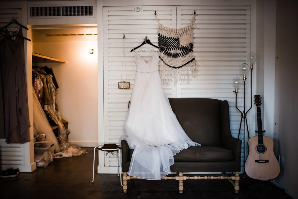 brides dress hanging up at the ace hotel