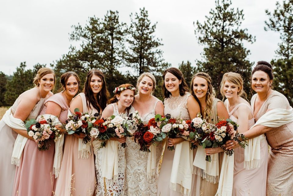 mismatched pink bridesmaids with bride