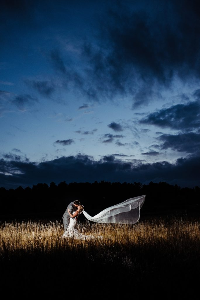 bride and groom with a dramatic veil using OCF