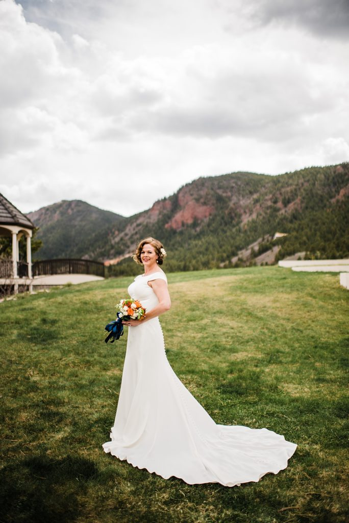 bridal portrait with green mountains behind her