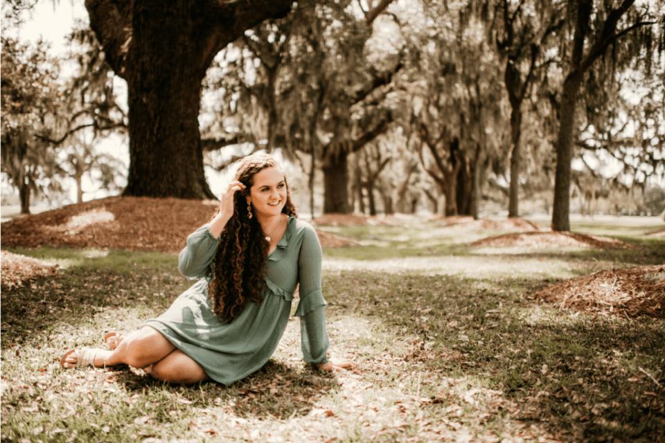 senior girl sitting down pose