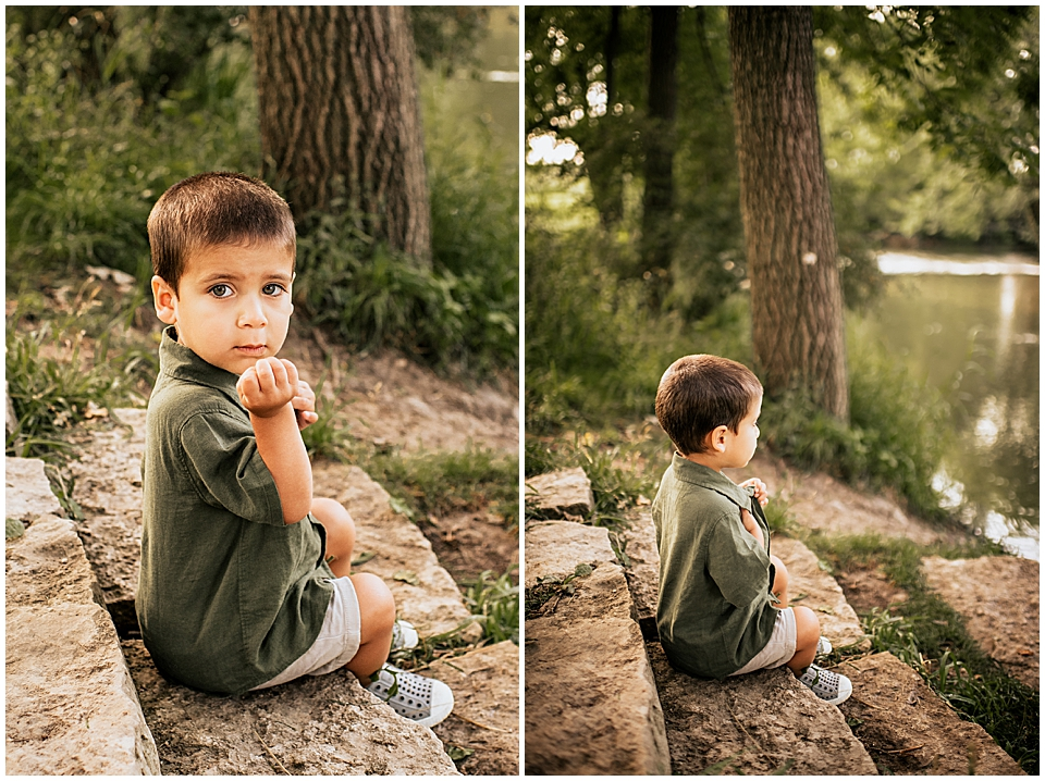 little boy sitting on river steps