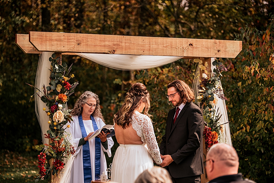 bride and groom praying together