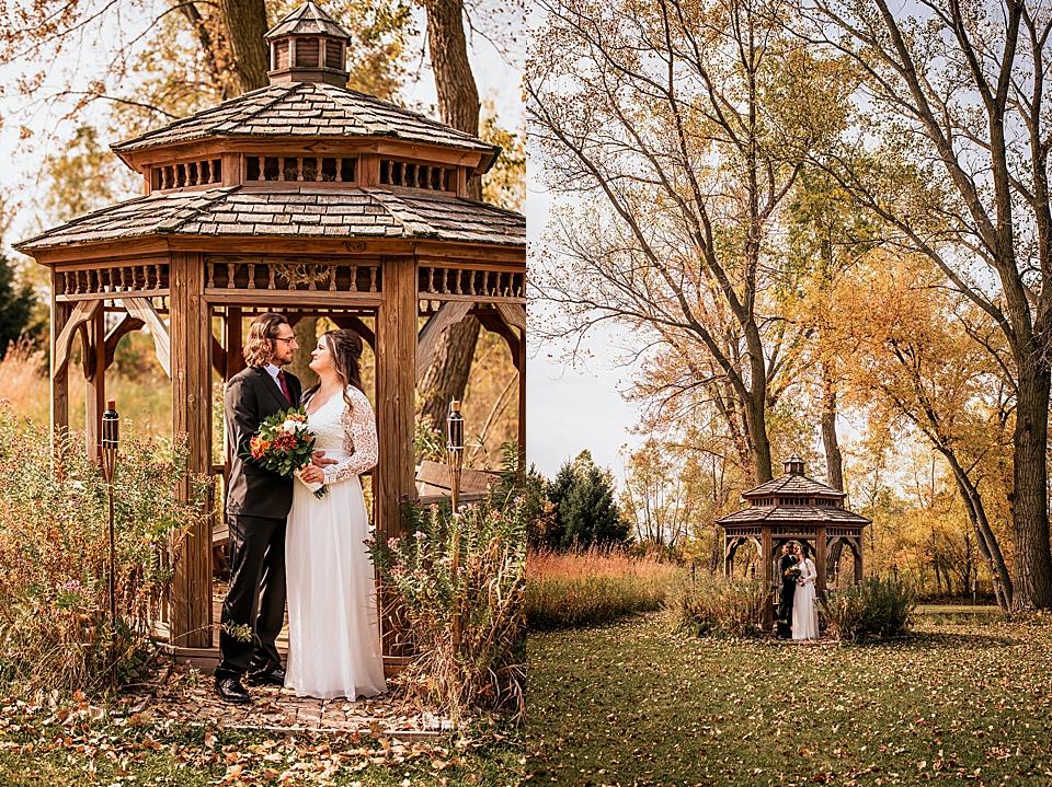 bride and groom in wood gazebo