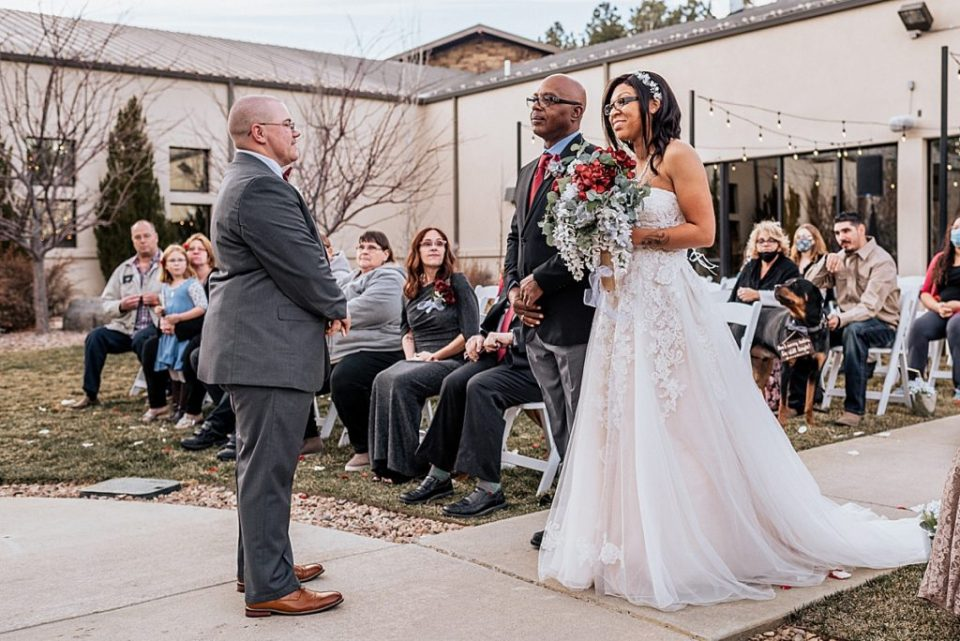 father walking daughter bride down the aisle