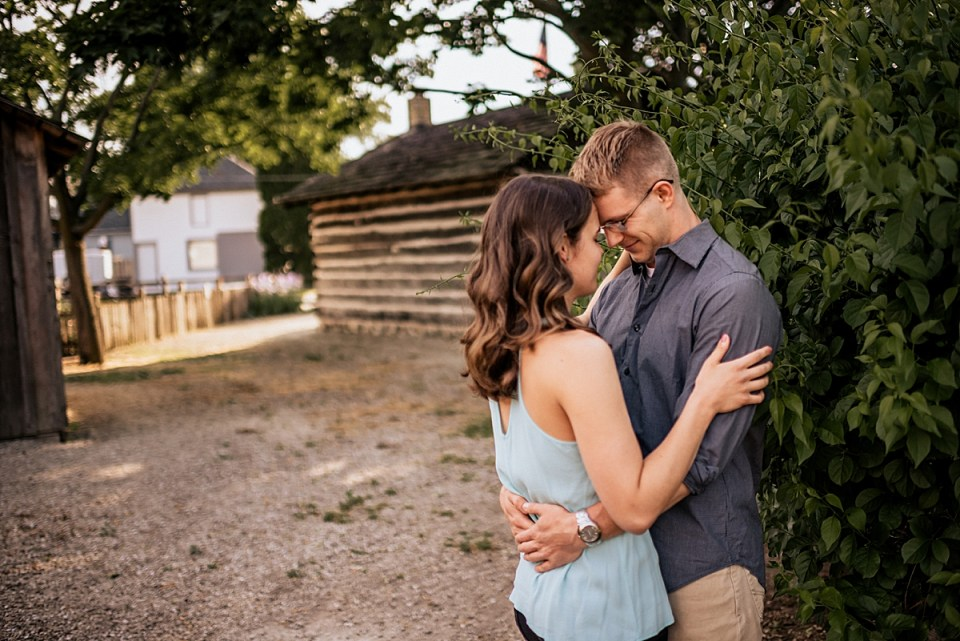engagement session next to historic log cabin