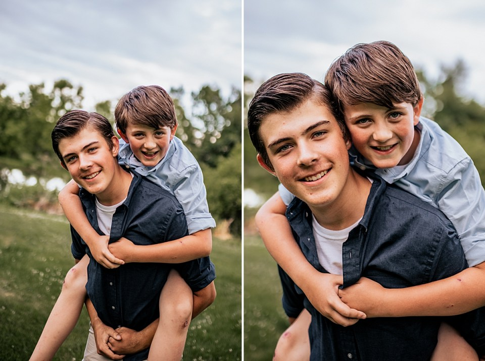 big brother giving little brother a piggyback ride