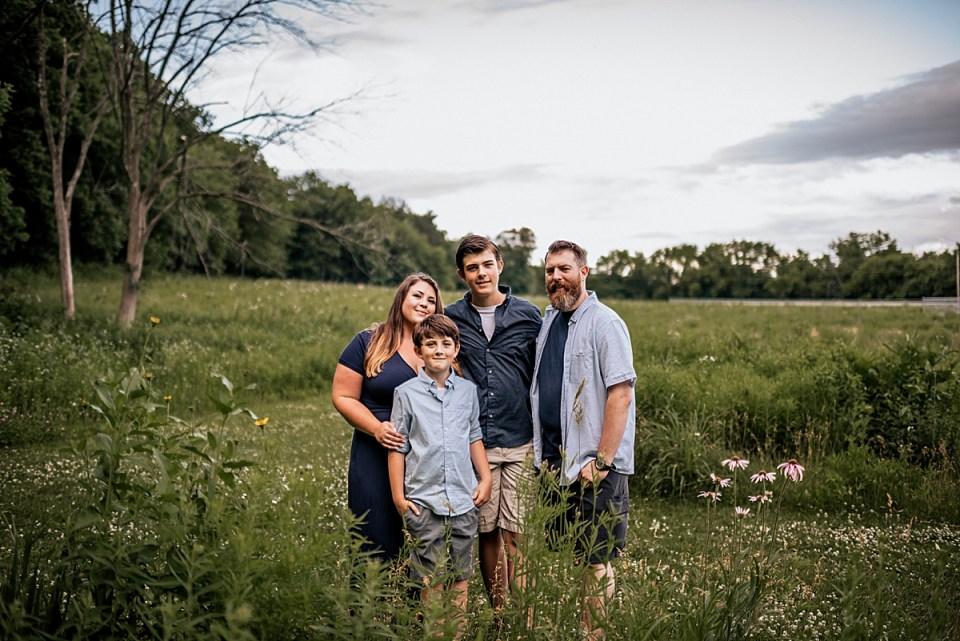 family in wild flowers in wisconsin