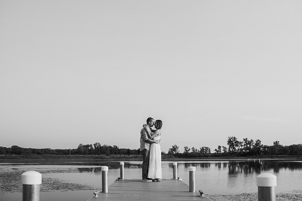 engaged couple dancing at the end of the pier