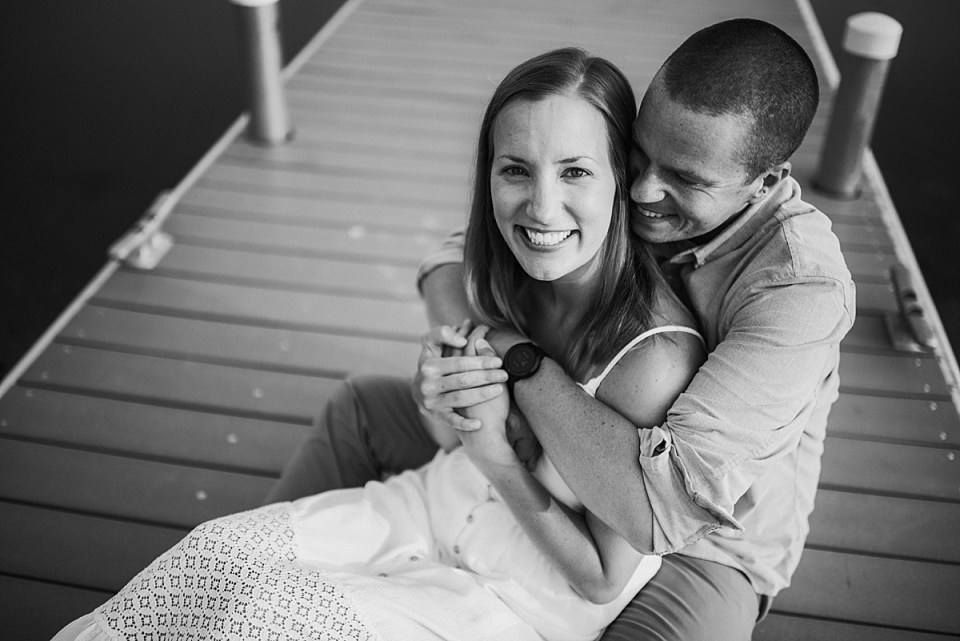 couple sitting together on a dock