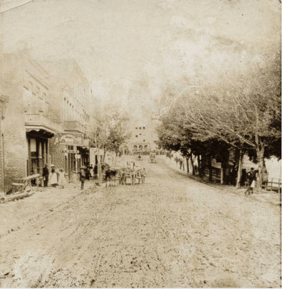 Muddy Patton Avenue, looking toward the Square, 1879. Pack Memorial Public Library