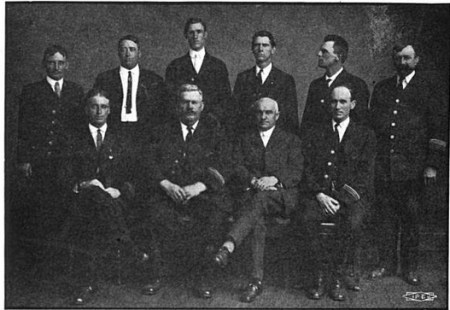 Div. 128 officers with International Vice President George Keenan (3rd from left, seated). Motorman and Conductor (1913).