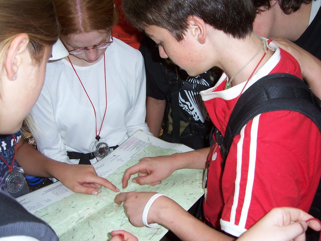Students studying the map