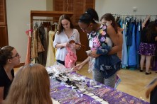 Mentees picking out jewelry to complete their look for prom, Photo: Caroline Dean