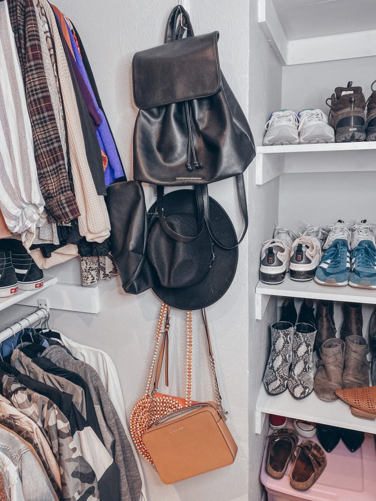 purses hanging on the wall to keep them organized hack