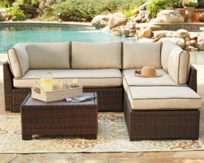 Patio Furniture     Bring Your Patio to Life   Ashley Furniture HomeStore     large Loughran 4 piece Outdoor Sectional Set    rollover