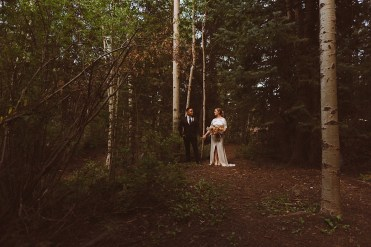 Bride and groom standing in the forest together in Colorado | Wedding portraits | Elopement portraits | Bride and groom elopement photos | Elopement wedding photos in Colorado | Colorado wedding photos | Colorado elopement photos | Elopement at Treehaus, Colorado |  Treehaus Colorado | Colorado elopement | Treehaus elopement | Colorado elopement venue | Colorado mountain elopement venue | Unique elopement venue | Elopement venue in Colorado | Ashley Joyce Photography 2020
