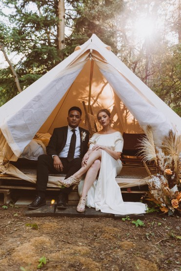 Bride and groom sitting in wedding tent at Treehaus Colorado | Wedding portraits | Elopement portraits | Bride and groom elopement photos | Elopement wedding photos in Colorado | Colorado wedding photos | Colorado elopement photos | Elopement at Treehaus, Colorado | Treehaus Colorado | Colorado elopement | Treehaus elopement | Colorado elopement venue | Colorado mountain elopement venue | Unique elopement venue | Elopement venue in Colorado | Ashley Joyce Photography 2020