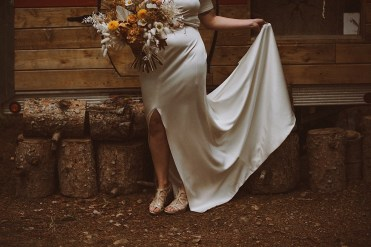 Bride dancing in her wedding dress by Lovely Bride Denver | Bride dancing in her Prea James wedding dress | Colorado bride dancing in her dress | Wedding portraits | Elopement portraits | Bride and groom elopement photos | Elopement wedding photos in Colorado | Colorado wedding photos | Colorado elopement photos | Elopement at Treehaus, Colorado |  Treehaus Colorado | Colorado elopement | Treehaus elopement | Colorado elopement venue | Colorado mountain elopement venue | Unique elopement venue | Elopement venue in Colorado | Ashley Joyce Photography 2020