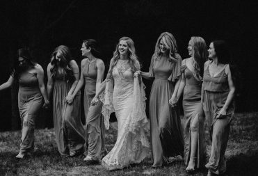 Black and white wedding photos with bridesmaids and bride by Ashley Joyce Photography