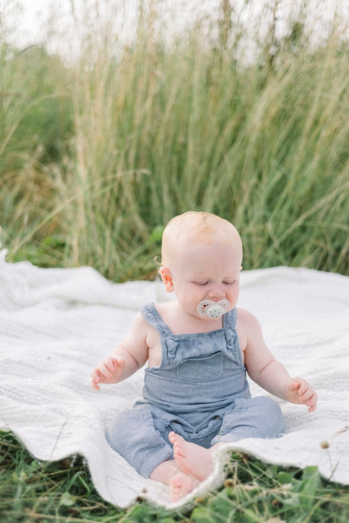 baby in field looking down Dayton Ohio family photography