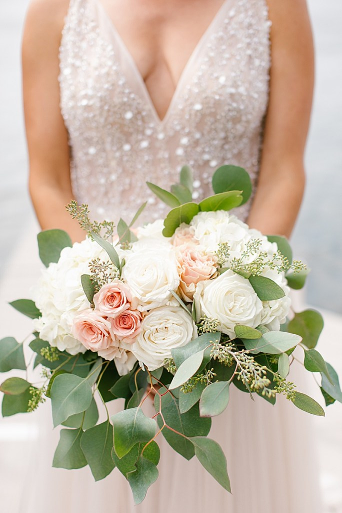 ivory and blush wedding bouquet for bride by lake with Ashley Mac Photographs
