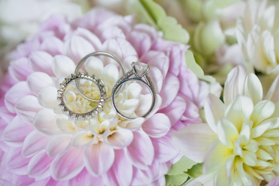 wedding jewelry on florals for summer wedding photographer by Ashley Mac Photographs