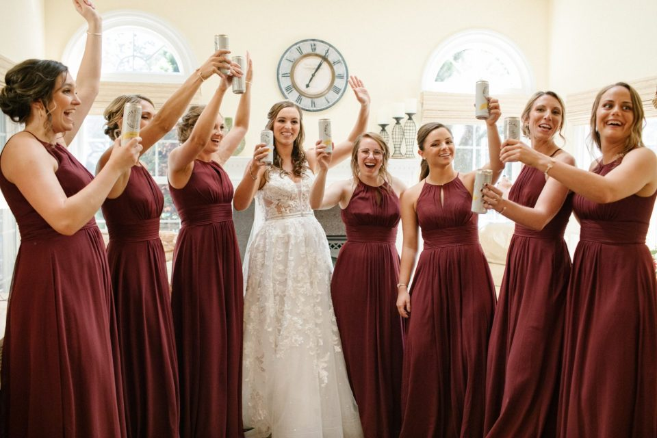 bridesmaids prepare for wedding with Ashley Mac Photographs