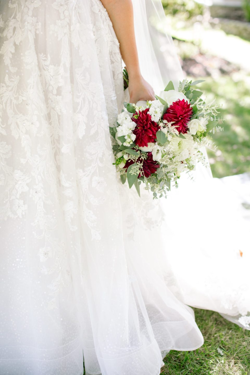 wedding bouquet with red and ivory florals with Ashley Mac Photographs
