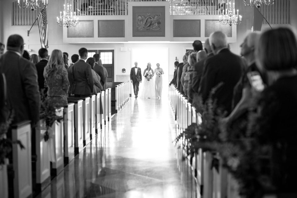bride enters Nativity Church wedding ceremony photographed by Ashley Mac Photographs