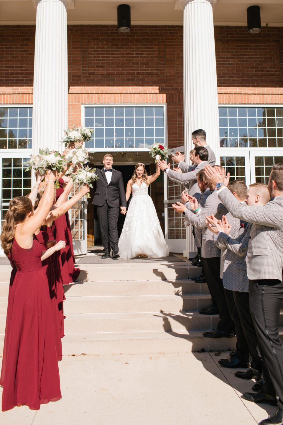 newlyweds leave church in NJ with Ashley Mac Photographs