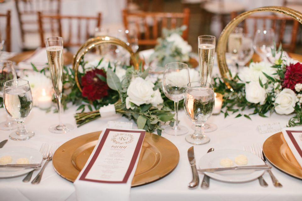 Ashley Mac Photographs photographs reception table with gold details