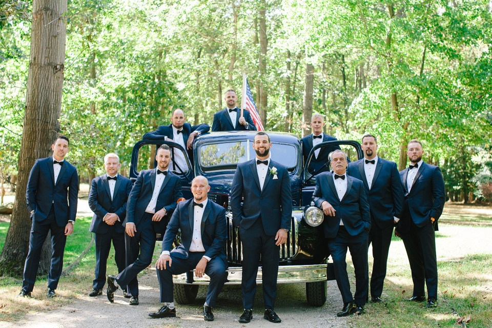 groom and groomsmen pose for New Jersey wedding day with Ashley Mac Photographs