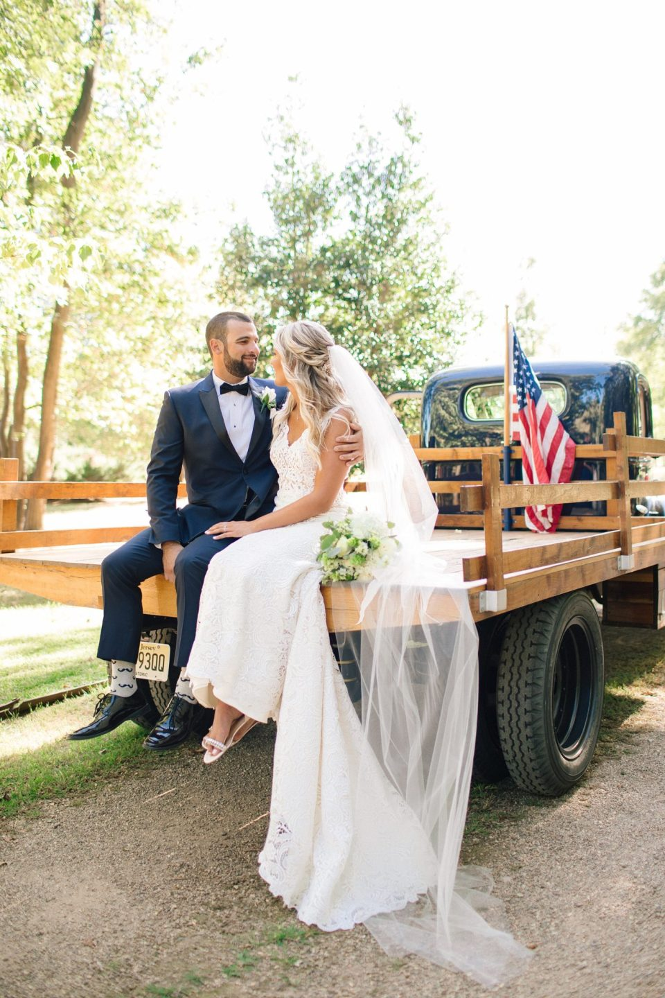 wedding portraits on vintage truck by Ashley Mac Photographs