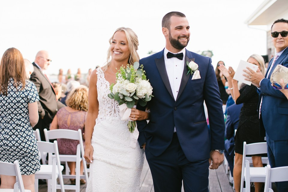 outdoor wedding ceremony at Rumson Country Club Riverhouse photographed by Ashley Mac Photographs