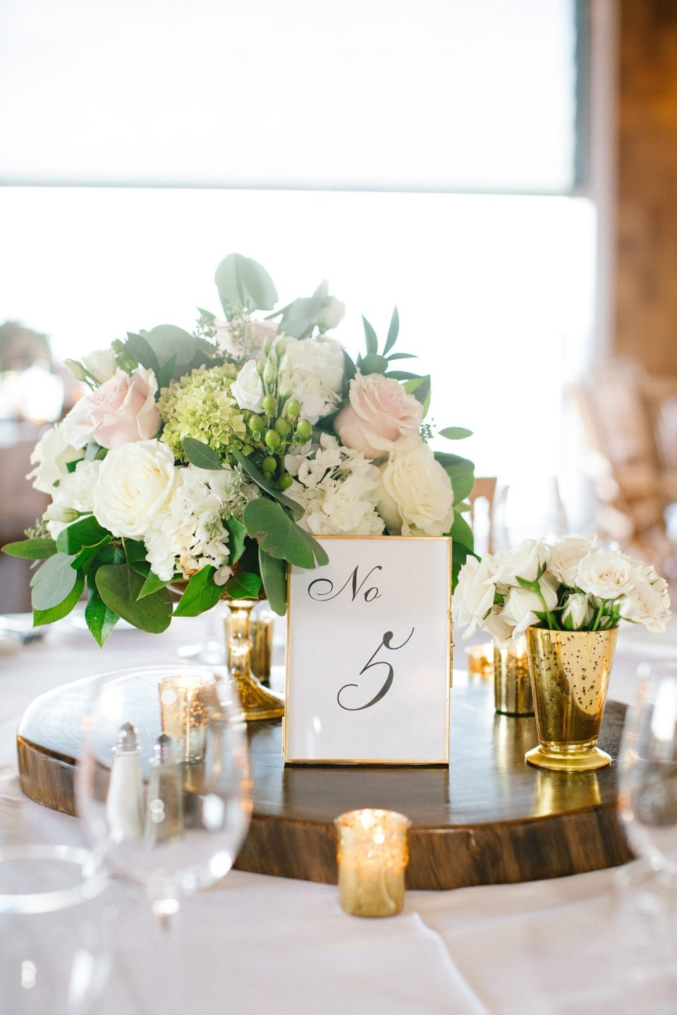 wedding centerpieces with rustic design photographed by Ashley Mac Photographs