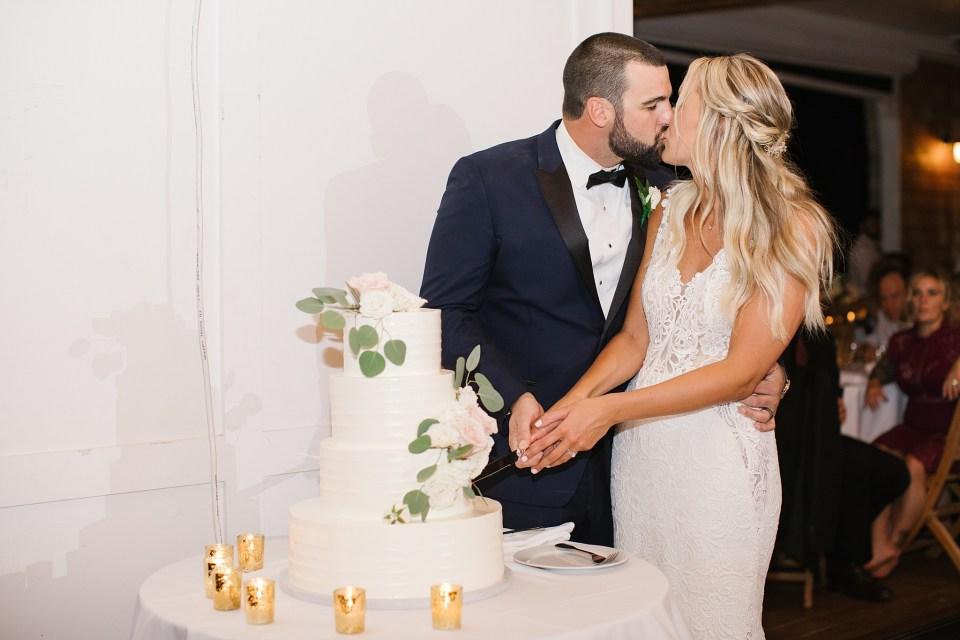 wedding cake cutting photographed by Ashley Mac Photographs
