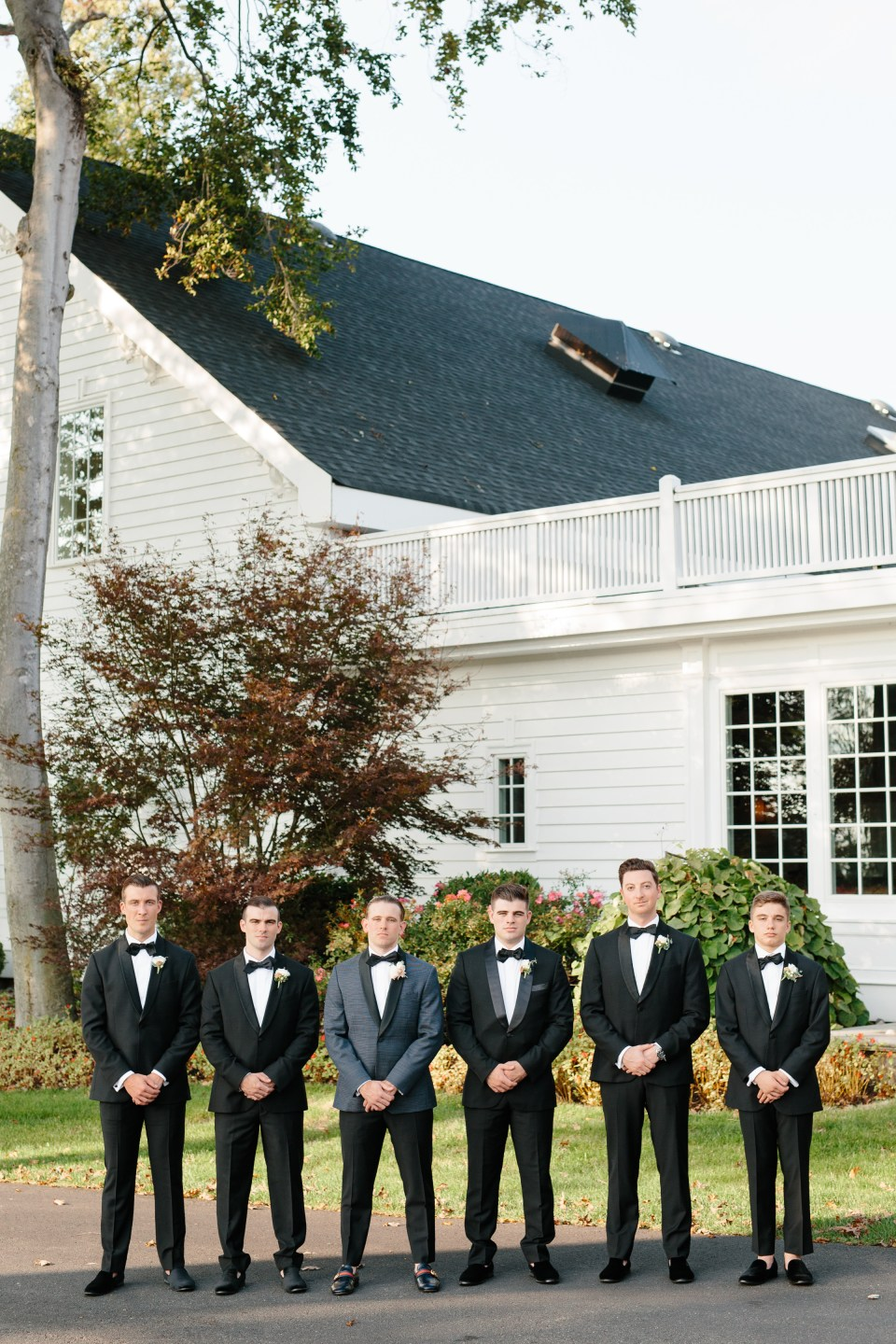 Ashley Mac Photographs photographs groomsmen at Ryland Inn