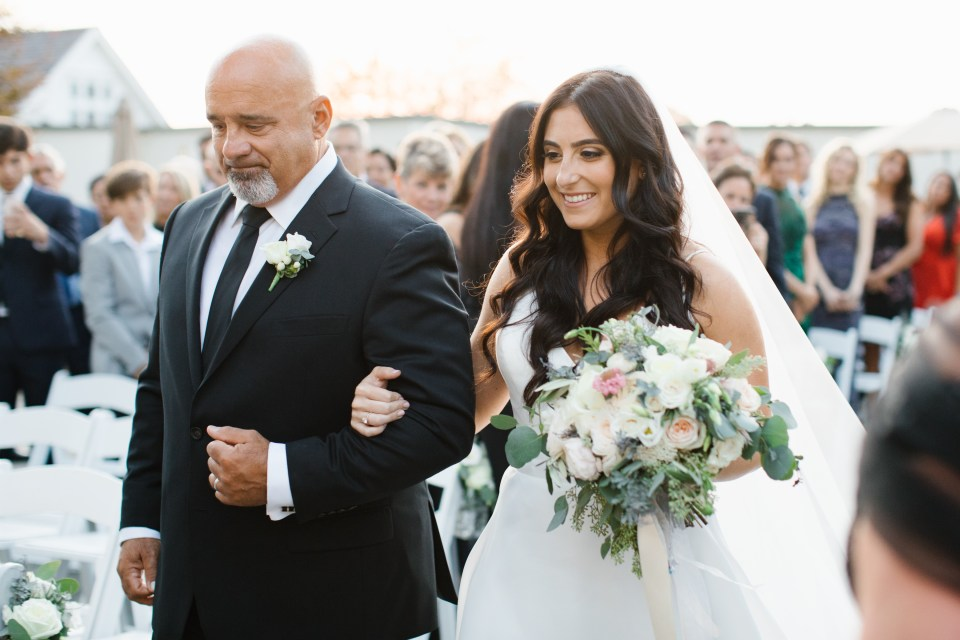 Ashley Mac Photographs photographs bride walking down aisle with father