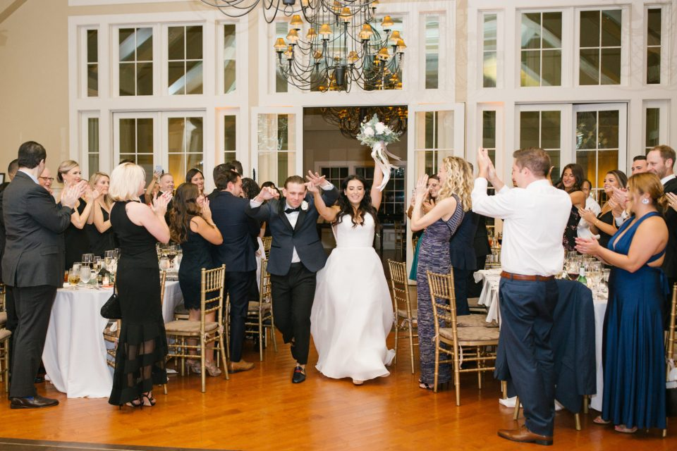 Ashley Mac Photographs photographs bride and groom entering wedding reception