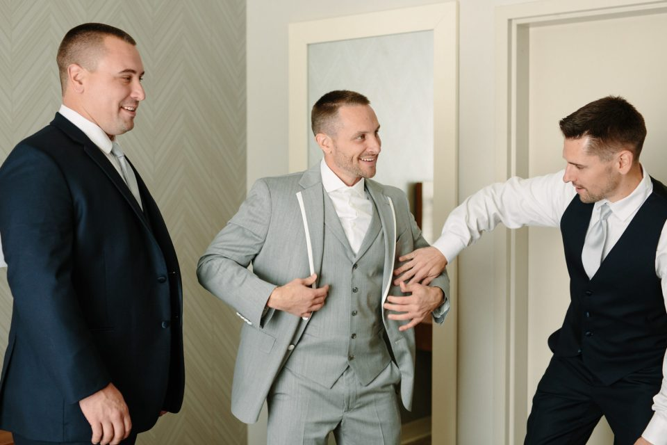 groom prepares for wedding day with Ashley Mac Photographs