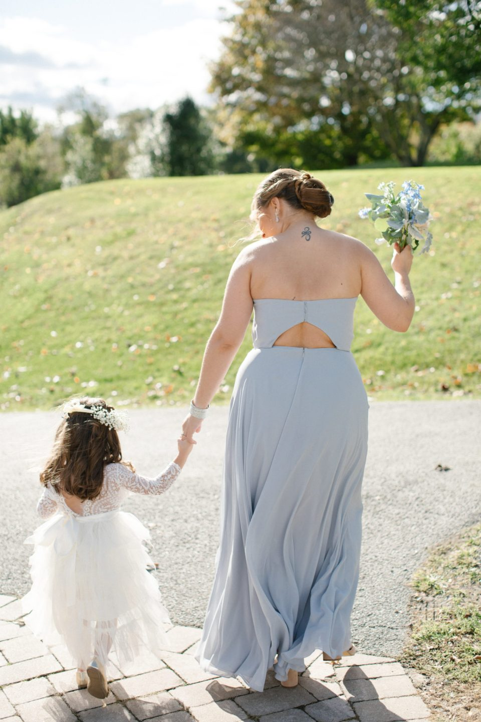 Ashley Mac Photographs photographs flower girl walking to photos