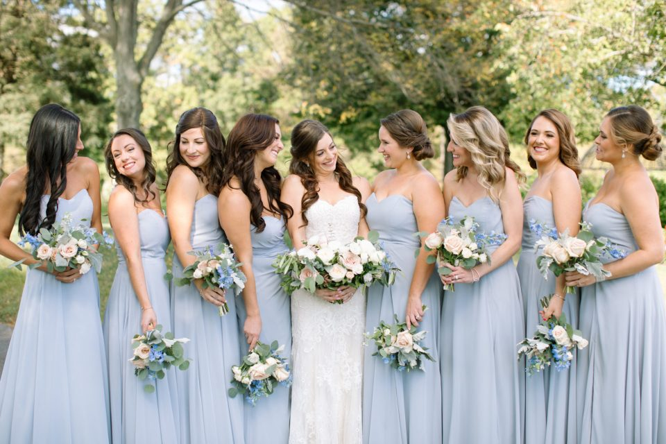 bridesmaids in dusty blue photographed by Ashley Mac Photographs