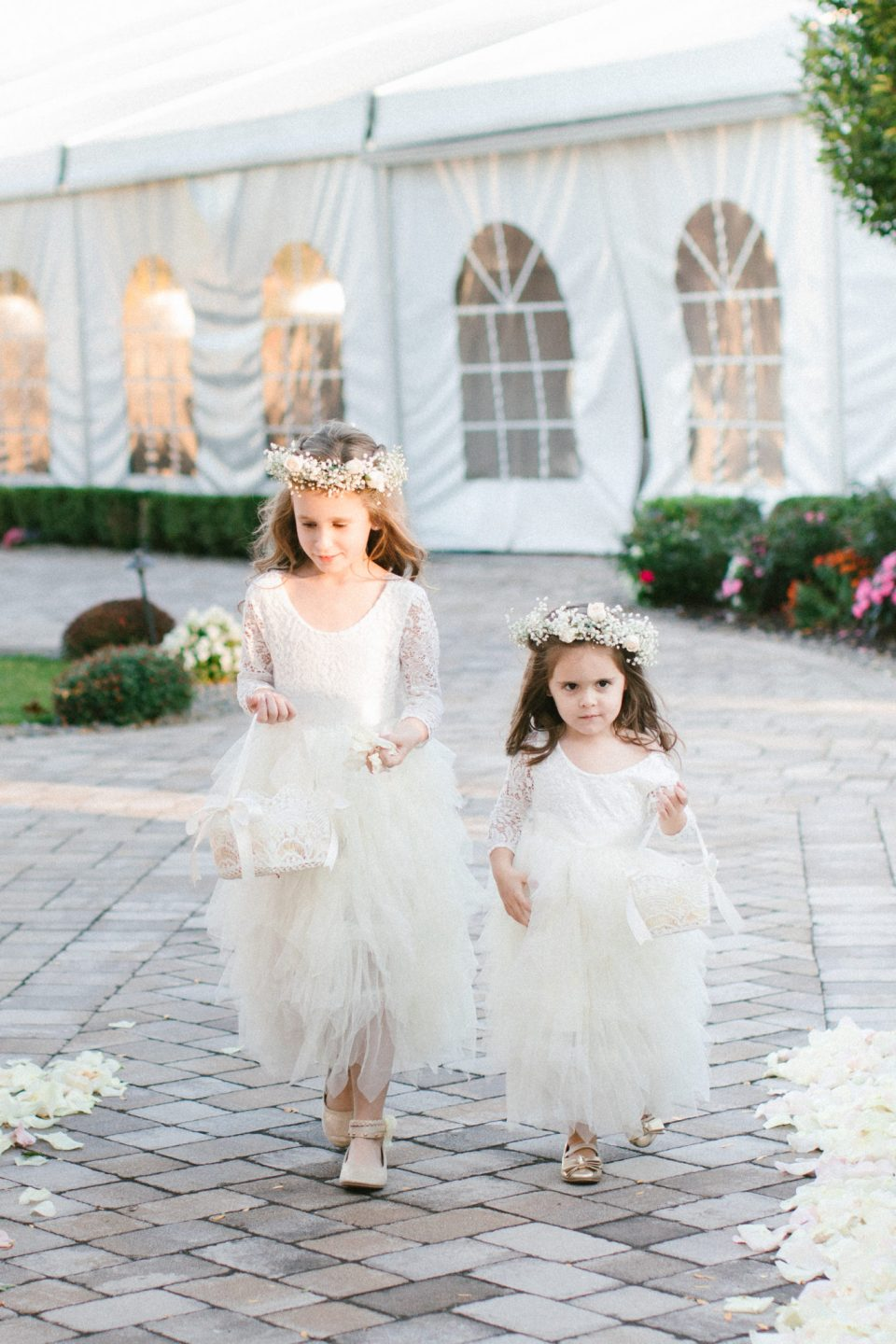 flower girls walk down the aisle at West Hills Country Club with Ashley Mac Photographs