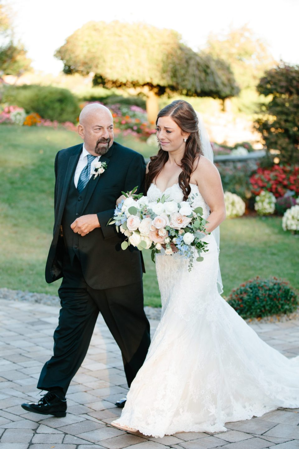 Ashley Mac Photographs photographs bride walking down the aisle with father