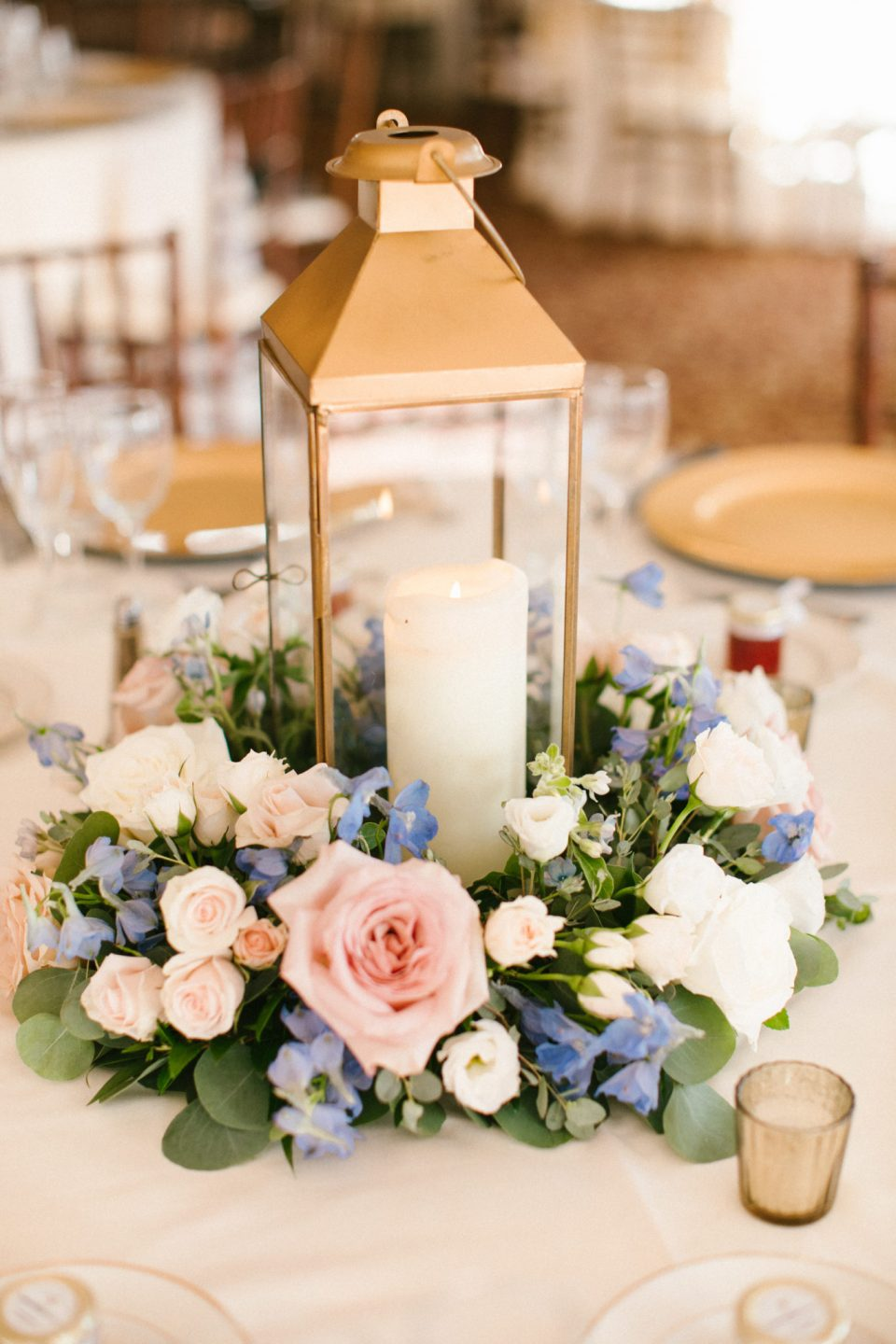 rustic lantern centerpieces by Whisper and Brook Florals photographed by Ashley Mac Photographs