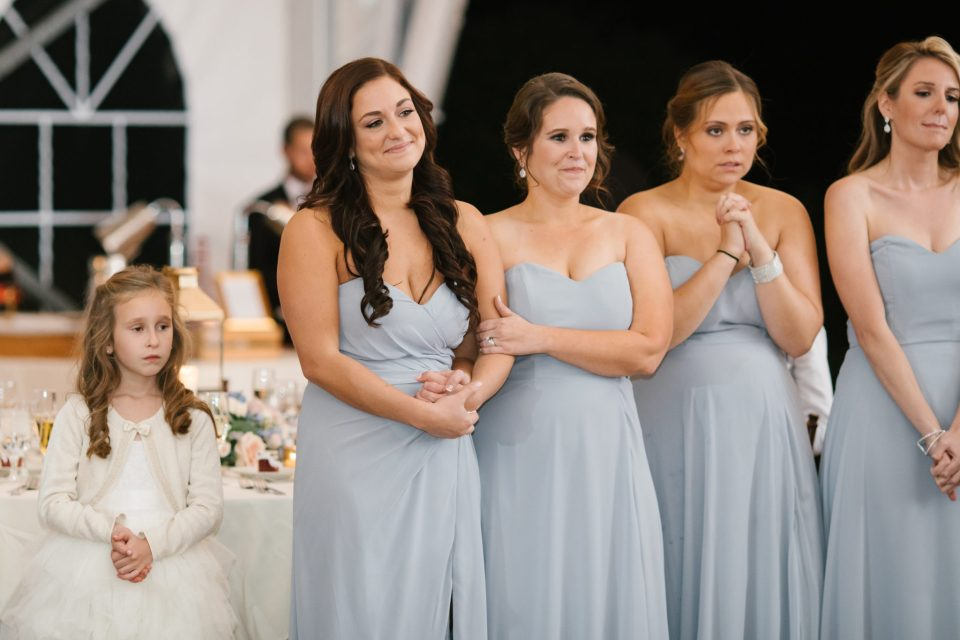 bridesmaids watch first dance photographed by Ashley Mac Photographs