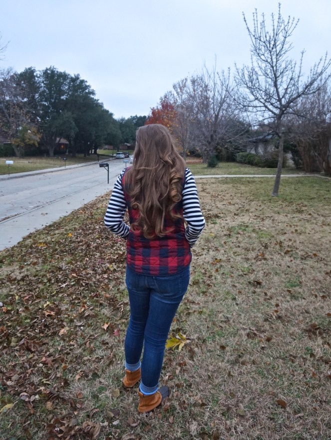 winter outfit with gingham vest and bean boots