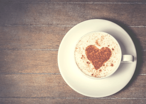 mug of hot cacao with chocolate shavings in a heart shape